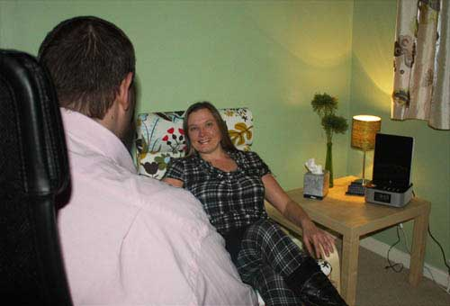 hypnotherapist talking to client